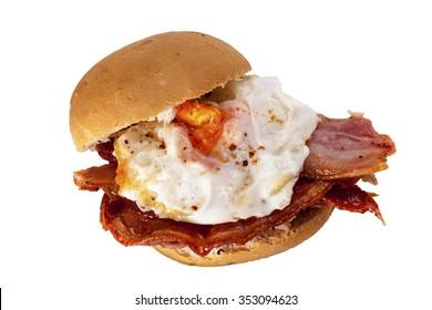 A delicious bacon and egg bun on a white background. Bacon and egg bun.