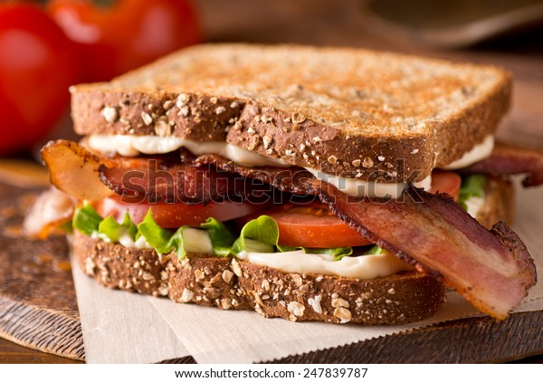 A delicious bacon, lettuce, and tomato blt sandwich.