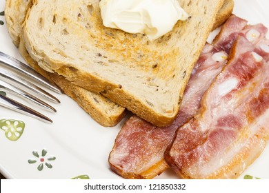 Delicious bacon with toast for breakfast. Close up