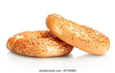 delicious bagels with sesame seeds isolated on white