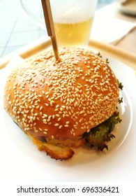delicious baked cheese burger on white plate prepared for eating