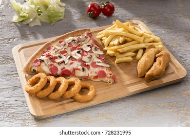 Delicious Baked Italian Homemade Pizza slice ingredients sliced sausage, mushroom, special tomato sauce, melted mozzarella cheese serving with french fries, onion rings and fried chicken beef nuggets.