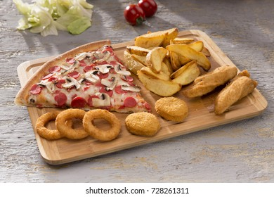 Delicious Baked Italian Homemade Pizza slice ingredients sliced sausage, mushroom, special tomato sauce, melted mozzarella cheese serving with potato wedges, onion rings and fried chicken beef nuggets