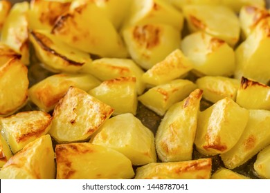 Delicious baked potatoes on glass plate, closeup