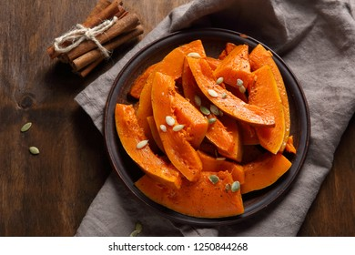 Delicious baked pumpkin on a plate, food top view