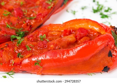 Delicious baked red paprika peppers stuffed with tomatoes and herbs. Macro. Photo can be used as a whole background.