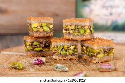 delicious baklava portion and Turkish coffee - Traditional Turkish dessert baklava with pistachio nuts on the white background.Close up taken,isolated.Religious Festivals.