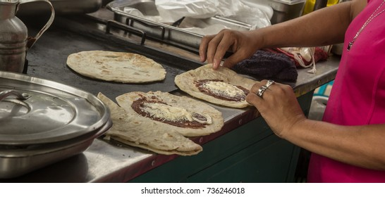 Delicious baleadas sold on the street at San Pedro Sula, Honduras.