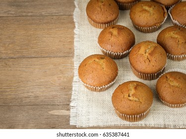 Delicious banana cake on wooden floor, background blurred.