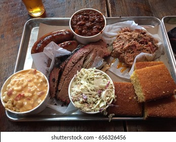 Delicious BBQ Barbeque consists of coleslaw, baked beans, macaroni and cheese, cornbread, brisket, pulled pork and sausage. Eating too much of this leads to obesity, high cholesterol, bad health.