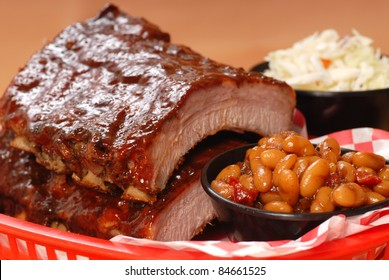 Delicious BBQ ribs with beans, cole slaw and a tangy BBQ sauce
