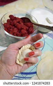 Delicious and beautiful homemade dumplings with sweet raspberry.