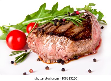 Delicious beef steak, medium grilled. Isolated on white background
