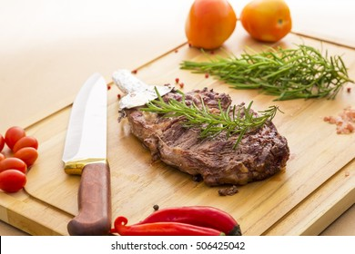 Delicious beef steak on wooden table, close-up.