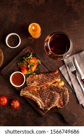 Delicious beef steak served on black wooden table set
