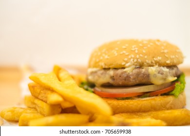 delicious big fat crafted hamburger served on brown decorative