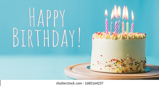 Delicious birthday cake with candle on light blue background. Space for text