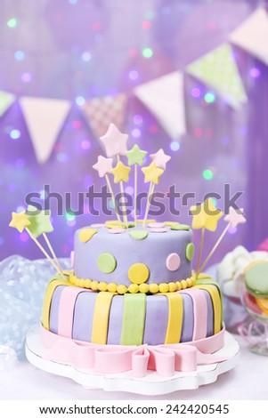 Delicious Birthday Cake On Shiny Purple Background