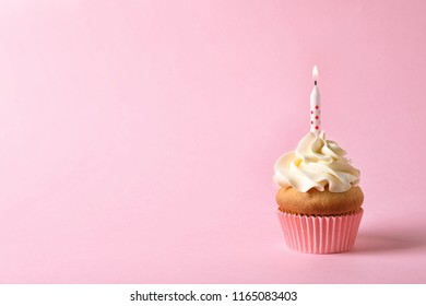 Delicious birthday cupcake with candle and space for text on color background