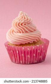 Delicious birthday cupcake with twirled pink icing decorated