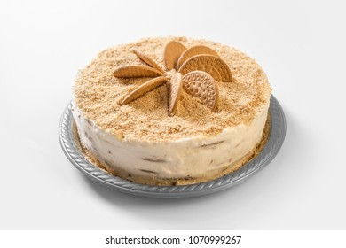 Delicious biscuit cake on white