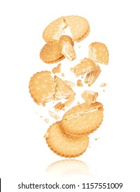 Delicious biscuits crushed into pieces in the air, isolated on a white background
