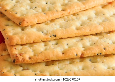 Delicious biscuits in stack. Stack of Graham Crackers Close Up on the Edges. Multi grain healthy crackers picture in macro key. Appetizer salt crackers with great texture. Food and breakfast.