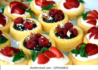 Delicious bite-sized raspberry, strawberry chocolate pretzel cheesecakes.