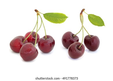 Delicious black sweet cherry with leaves isolated on a white background