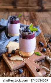 Delicious blueberry cheesecake in a glass jar