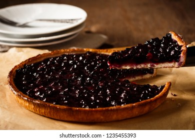 Delicious blueberry pie on wooden table