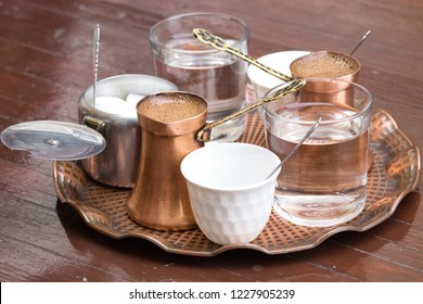Delicious Bosnian coffee is served with rahat lokum dessert in the traditional turkish coffee pot