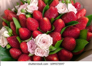 Delicious bouquet of strawberries and roses. Close up