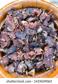 A delicious bowl of biltong, a traditional South African snack similar to beef jerky, in a bowl.