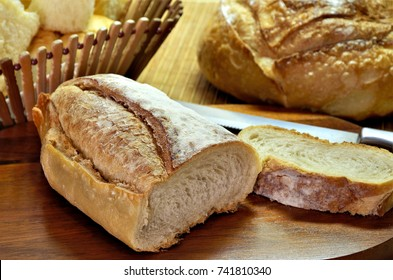 Delicious breads on wooden table seen from above.