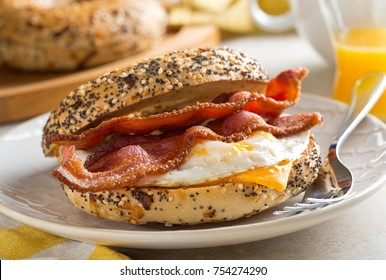 A delicious breakfast bagel with bacon, egg and cheese.
