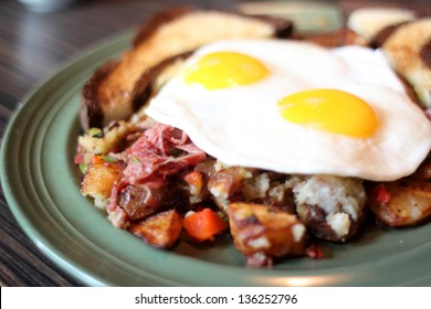 Delicious breakfast with corned beef hash and eggs.