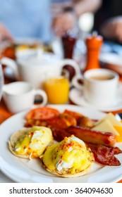 Delicious breakfast with eggs Benedict, bacon, orange juice and coffee