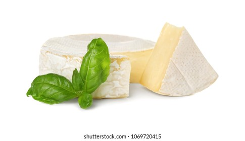 Delicious brie cheese with basil on white background