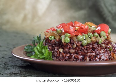 A delicious brown rice with vegetables and parsley.