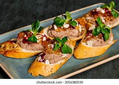 Delicious bruschettas with pate on plate, closeup