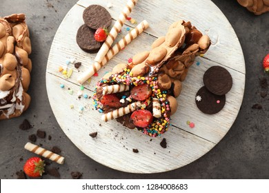 Delicious bubble waffle on wooden board