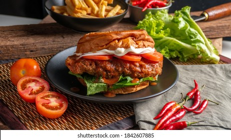 Delicious buffalo chicken sandwich with mayo tomato and lettuce