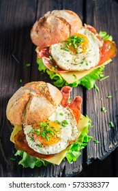 Delicious burger with lettuce, bacon and eggs