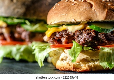 Delicious burger on a wooden background