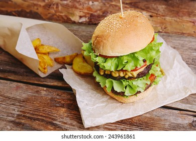 Delicious burger on the wooden table