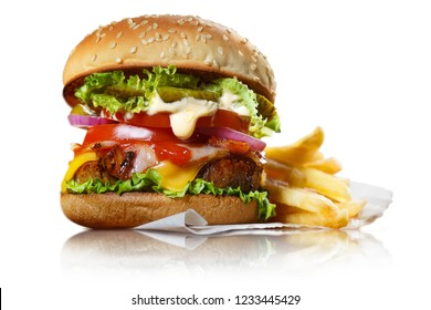 Delicious burger with potato fries, isolated on white background