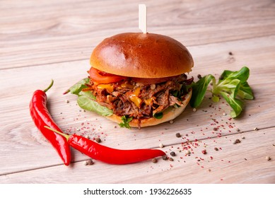 Delicious burger with shredded meat and vegetables