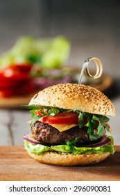 Delicious burgers with beef, tomato, cheese and lettuce