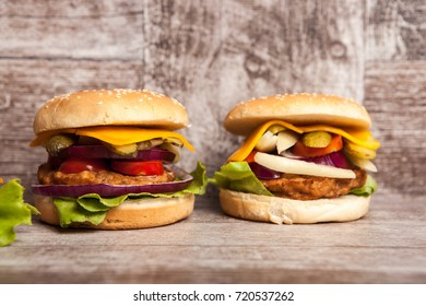 Delicious burgers on wooden background. Fast and tasty food